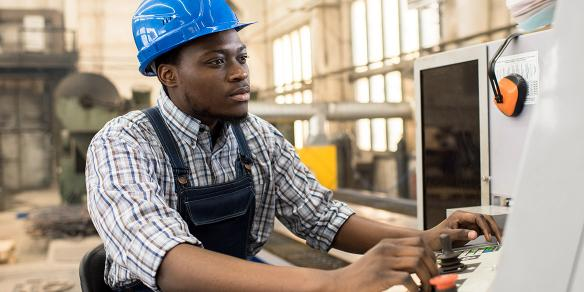 Image of technician working at a computer